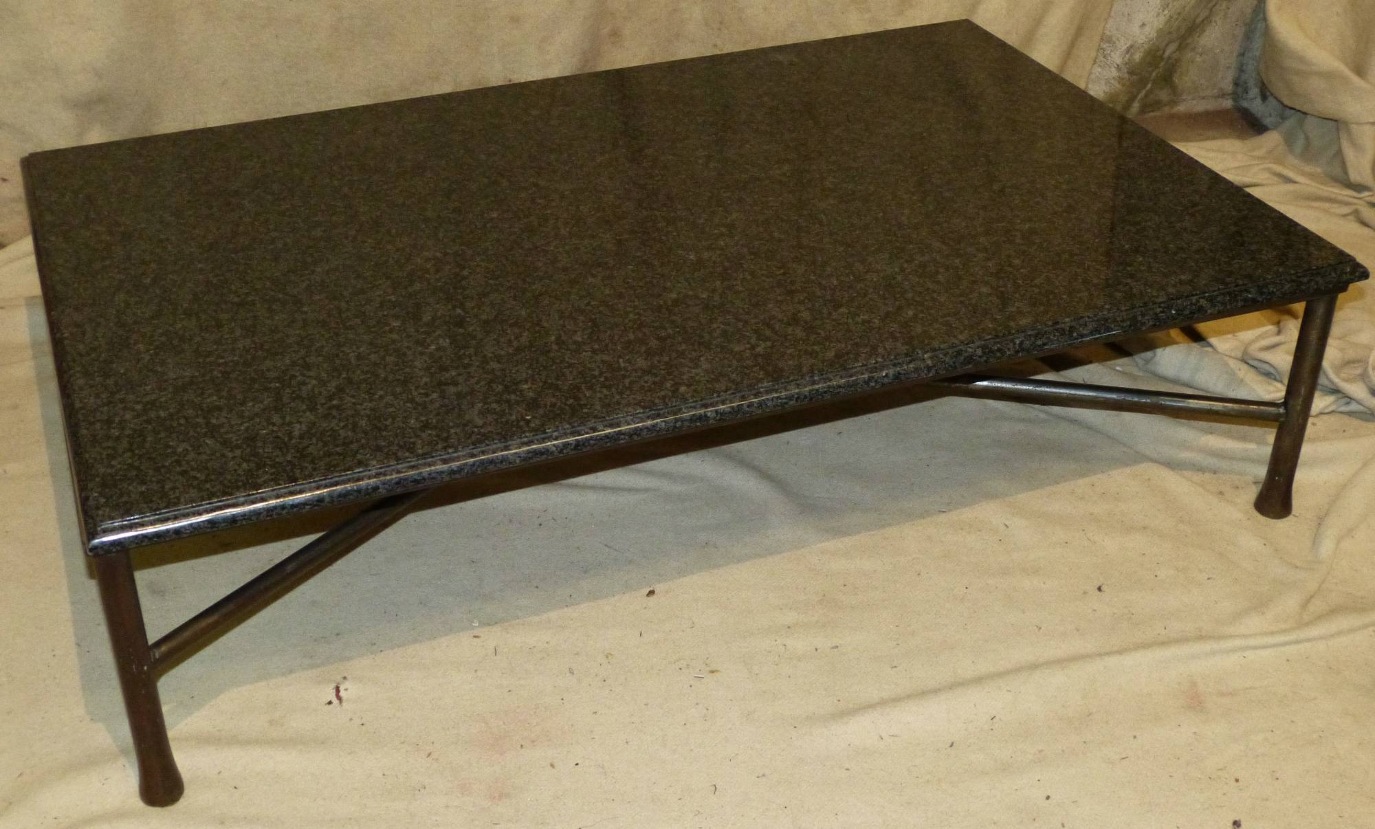 A Black And Grey Granite Top Rectangular Coffee Table From P F Windibank