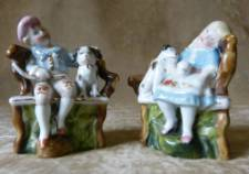 A Pair of China Match Holders in form of seated children with dogs, 8cm high