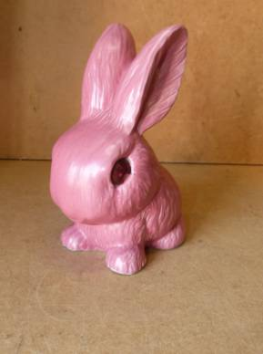 A Sylvac Figure of a rabbit on pink ground, 21.5cm high