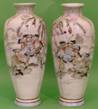 A Pair of Japanese Round Bulbous Thin Necked Trumpet Shaped Vases on cream ground with multicoloured, warrior and river landscape decoration 37cm high